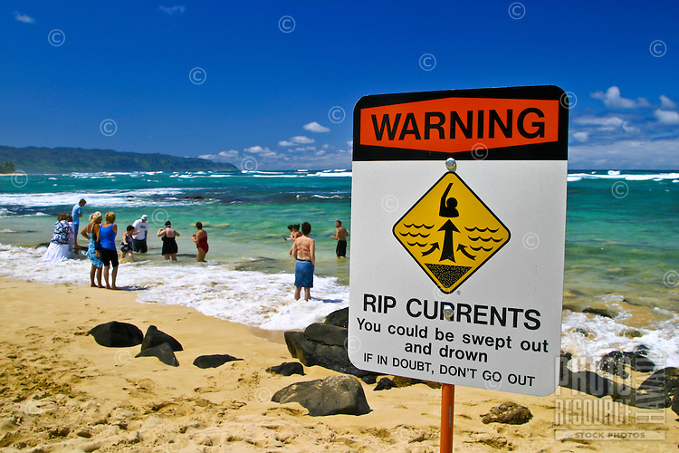 Signs warn swimmers to be aware of strong Rip Currents along north shore beaches. This photo taken at Laniakea Beach on Oahus north shore.