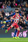 Kevin Gameiro of Atletico de Madrid fights for the ball with Gerard Pique Bernabeu of FC Barcelona during their Copa del Rey 2016-17 Semi-final match between FC Barcelona and Atletico de Madrid at the Camp Nou on 07 February 2017 in Barcelona, Spain. Photo by Diego Gonzalez Souto / Power Sport Images