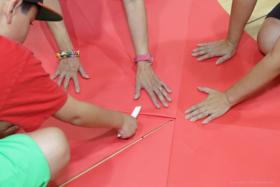 The oversized folding event. Team Philly Fire Dragons fold Wen's Dragon by Sok Song. Team members: Thu Tran, Khai Feldman, Margaret Wong