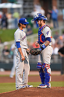 South Bend Cubs relief pitcher Kyle Miller (40) talks with catcher Tyler Alamo (22) during a game against the Dayton Dragons on May 11, 2016 at Fifth Third Field in Dayton, Ohio.  South Bend defeated Dayton 2-0.  (Mike Janes/Four Seam Images)