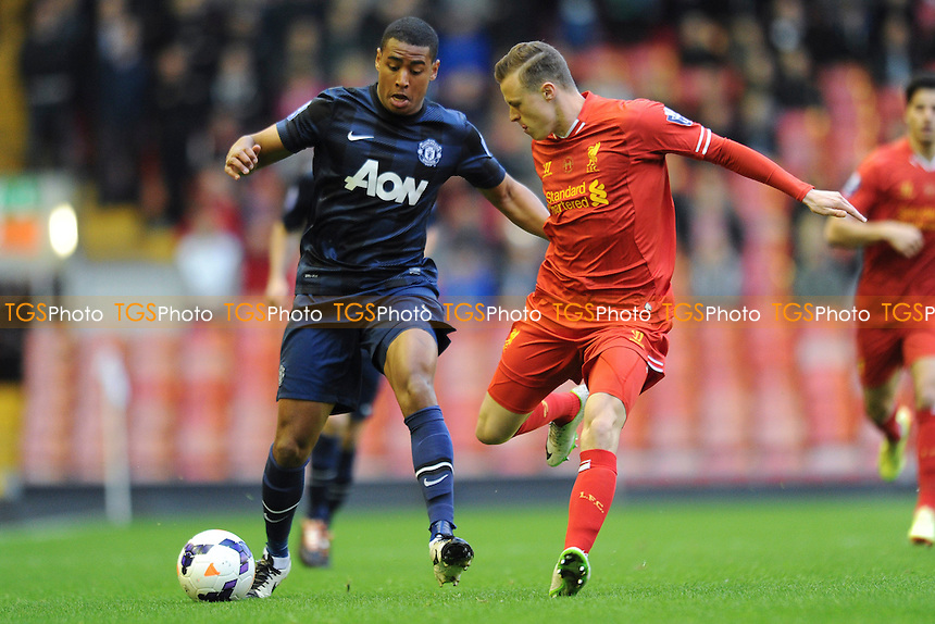 Saidy Janko of Manchester United vies for the ball with Brad Smith of Liverpool - Liverpool Under-21 vs Manchester United Under-21 - Barclays Under-21 Premier League Football at Anfield, Liverpool - 02/05/14 - MANDATORY CREDIT: Greig Bertram/TGSPHOTO - Self billing applies where appropriate - 0845 094 6026 - contact@tgsphoto.co.uk - NO UNPAID USE