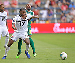 Mekeil Williams (17) of Trinidad and Tobago (left) and Callum Harriott (11) of Guyana vie for the ball during their Gold Cup match on June 26, 2019 at Children's Mercy Park in Kansas City, KS.<br /> Tim VIZER/AFP
