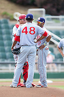Willie Medina (17) of the Hagerstown Suns translates for catcher Spencer Kieboom (20) as he talks to starting pitcher Reynaldo Lopez (48) during the game against the Kannapolis Intimidators at CMC-Northeast Stadium on June 1, 2014 in Kannapolis, North Carolina.  The Intimidators defeated the Suns 5-1 in game one of a double-header.  (Brian Westerholt/Four Seam Images)
