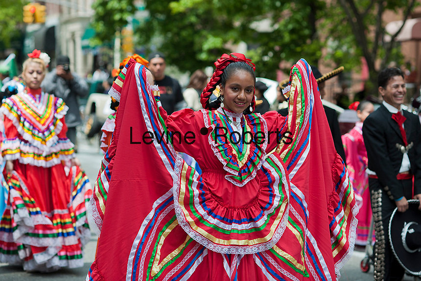 Dancers in the Cinco de Mayo Parade in New York on Sunday, May 6, 2012. The holiday commemorates a victory of Mexican forces led by General Ignacio Zaragoza Seguín over French forces in the Battle of Puebla on May 5, 1862. In the United States Mexican-Americans celebrate with parades and festivals as a show of ethnic pride.  (© Richard B. Levine)