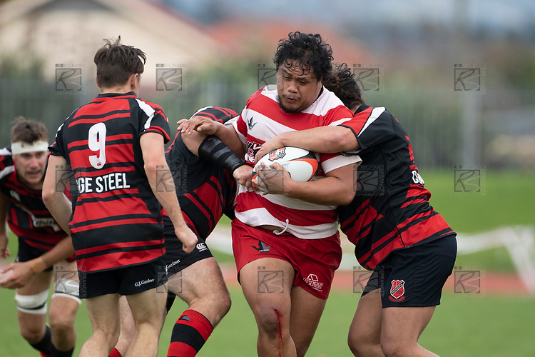 Tahu Hollis muscles his way through the Papakura defenders. Counties Manukau Premier Club Rugby game between Papakura and Karaka played at Massey Park Papakura on Saturday May 5th 2018. Papakuar won the game 28 - 25 after trailing 6 - 12 at halftime.<br /> Papakura - Faalae Peni, Darryl Hemopo, George Crichton, Federick Cain tries, Faalae Peni conversion; Faalae Peni 2 penalties, Karaka -Salesitangi Savelio, Cardiff Vaega, Walter Fifita tries, Juan Benadie 2 conversions, Juan Benadie 2 penalties.<br /> Photo by Richard Spranger.