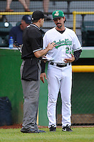 Manager Scott Steinmann #22 of the Clinton LumberKings discusses call with home plate umpire during the game against the West Michigan Whitecaps at Ashford University Field on July  25, 2014 in Clinton, Iowa. The Whitecaps won 9-0.   (Dennis Hubbard/Four Seam Images)