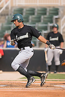 Shortstop Juan Lagares (4) of the Savannah Sand Gnats follows through on his swing at Fieldcrest Cannon Stadium in Kannapolis, NC, Sunday July 20, 2008. (Photo by Brian Westerholt / Four Seam Images)