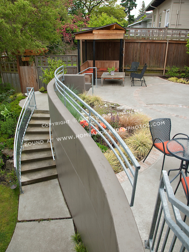 Patio seating in a multi-level garden