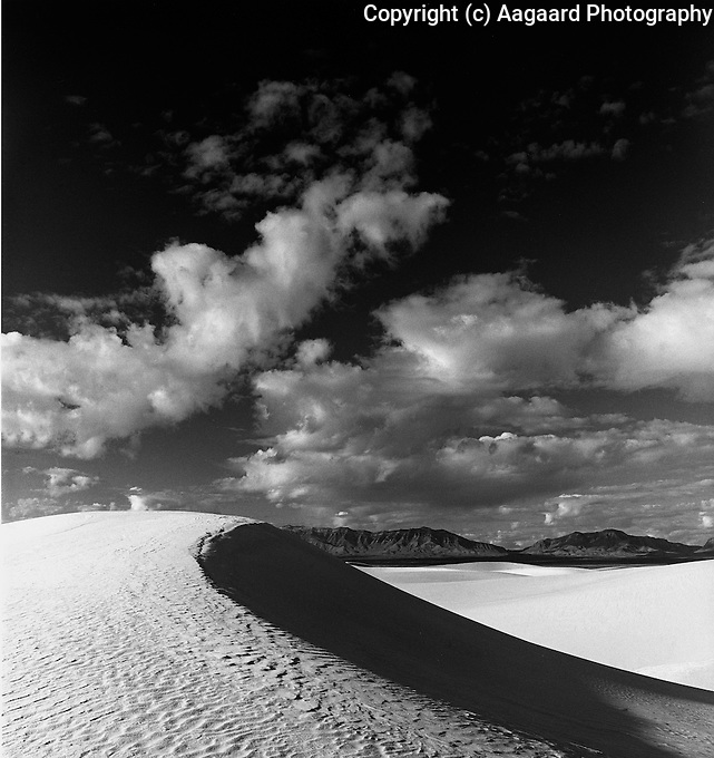 White Sands and clouds.<br /> <br /> Mamiya RB67 Pro SD, 65mm lens, Kodak Tri-X film, red filter