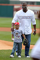 Buffalo Bills running back Fred Jackson helps son Braeden set up to throw out a first pitch before a Buffalo Bisons game against the Lehigh Valley IronPigs at Coca-Cola Field on April 19, 2012 in Buffalo, New York.  Lehigh Valley defeated Buffalo 8-4.  (Mike Janes/Four Seam Images)