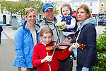 Megan O'Shea-Wheldon plays a tune for Maria, Aidan and Ayda O'Connor and Breeda O'Shea during the busking competition  at the K Fest Arts and Music festival in Killorglin on Sunday