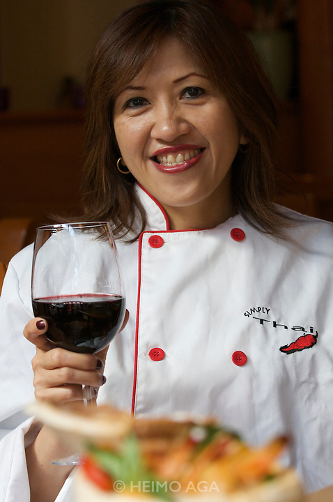 Yaletown. Simply Thai restaurant. Owner and Executive Chef Grace (Siriwan Rerksuttisiridach) suggests a good glass of wine should be enjoyed along with her delicious food. Bangkok born and raised, she apprenticed under Penpan Sittitrai, teacher of Royal Thai Chefs for the Royal Family of Thailand.