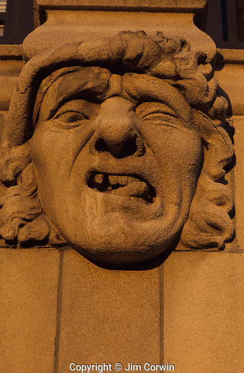 "Gargole on side of building at sunset, grotesque expression, along the ""AVE"" University District, Seattle, Washington State USA"