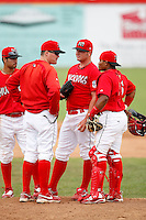 June 21, 2009:  Pitching Coach Timothy Leveque of the Batavia Muckdogs talks with pitcher Daniel Calhoun, Catcher Luis De La Cruz, and Third Baseman Niko Vasquez during a game at Dwyer Stadium in Batavia, NY.  The Muckdogs are the NY-Penn League Short-Season Class-A affiliate of the St. Louis Cardinals.  Photo by:  Mike Janes/Four Seam Images