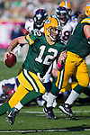 Green Bay Packers quarterback Aaron Rodgers (12) scrambles for yardage during a Week 4 NFL football game against the Denver Broncos on October 2, 2011 in Green Bay, Wisconsin. The Packers won 49-23. (AP Photo/David Stluka)
