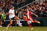 Western New York Flash midfielder Carli Lloyd (10) is marked by Portland Thorns midfielder Allie Long (10). The Portland Thorns defeated the Western New York Flash 2-0 during the National Women's Soccer League (NWSL) finals at Sahlen's Stadium in Rochester, NY, on August 31, 2013.