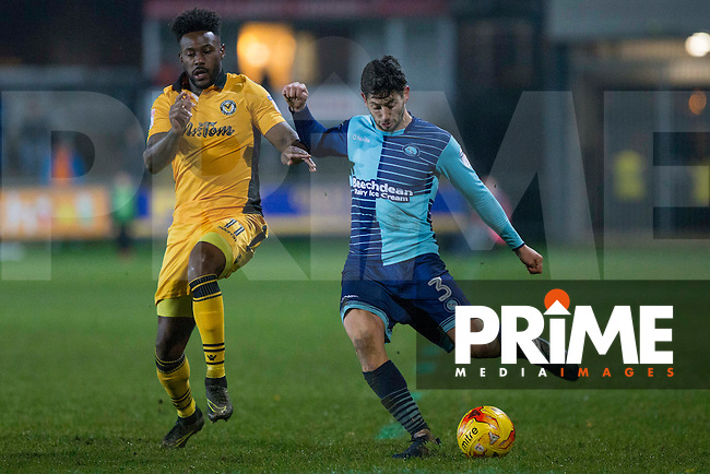 Joe Jacobson of Wycombe Wanderers crosses under pressure from Jennison Myrie-Williams of Newport County during the Sky Bet League 2 match between Newport County and Wycombe Wanderers at Rodney Parade, Newport, Wales on 22 November 2016. Photo by Mark  Hawkins.