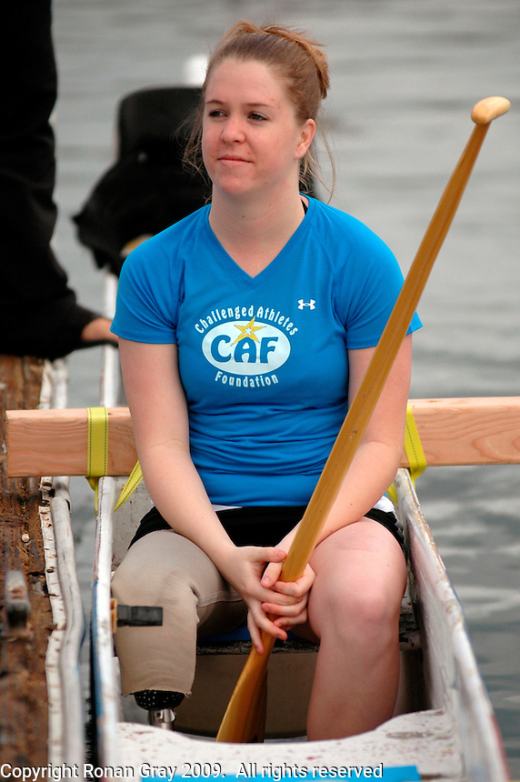 Saturday, 01/24/09.  Campland on the Bay, Mission Bay, San Diego, CA, USA.  Ariel Rigmey waits for others to board one of San Diego Outrigger Clubs canoes during an event sponsored by the Challenged Athletes Foundation.  The participants had the opportunity to try several different paddle sports. The Challenged Athletes Foundation established the Operation Rebound fund to provide sports opportunities and support for troops, veterans and first responders who have suffered permanent physical injuries in the line of duty.