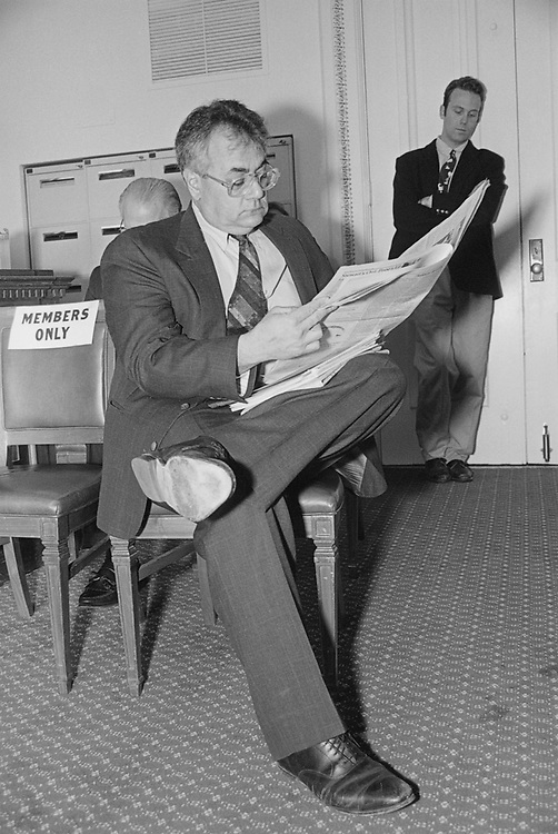 Party member reading news paper in office, in March 1994. (Photo by Maureen Keating/CQ Roll Call via Getty Images)