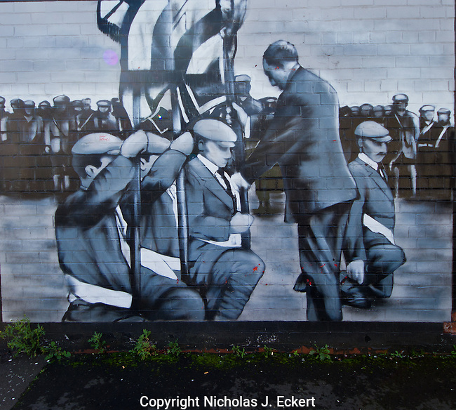 "This mural shows Sir Edward Carson in 1912 ""consecrating"" the colors of the Ulster Volunteer Force, an exclusively Protestant militia that was formed to oppose Home Rule...with the use of force if necessary --with the weapons provided by the Kaiser's Germany, which is rather ironic to say the least (taking arms from Britain's enemy to remain ""British"")."