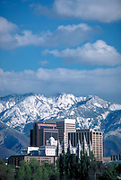 Latter Day Saints Temple and downtown office buildings in Salt Lake City, Utah with snowcovered Wasatch Mountains in the background. (Mormon) cityscape, urban design, skyline. Salt Lake City Utah.