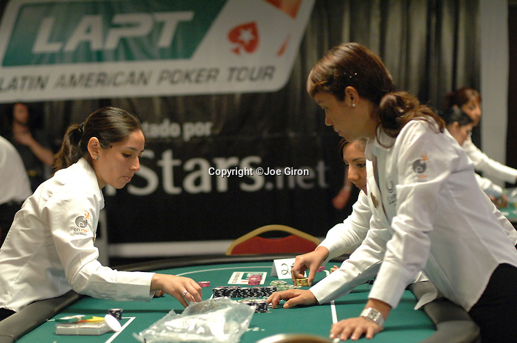 Dealers prepare their tables for the  start of action