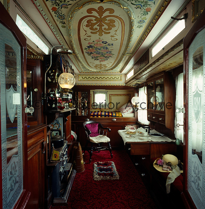 The interior of the Victorian wagon has an original cast-iron range and a painted ceiling with a bunk at the far end