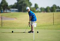 NWA Democrat-Gazette/CHARLIE KAIJO Carson Thomas, 7, of Siloam Springs putts during a junior golf tournament, Sunday, June 10, 2018 at The First Tee Learning Center in Lowell.<br /><br />A joint initiative founded in 2013 by the Masters Tournament, United States Golf Association and The PGA of America, the Drive, Chip and Putt Championship is a free nationwide junior golf development competition aimed at growing the game by focusing on the three fundamental skills employed in golf.<br /><br />By tapping the creative and competitive spirit of girls and boys ages 7-15, the Drive, Chip and Putt Championship provides aspiring junior golfers an opportunity to play with their peers in qualifiers around the country. Participants who advance through local, sub-regional and regional qualifying in each age/gender category earn a place in the National Finals, which is conducted at Augusta National Golf Club the Sunday before the Masters Tournament and is broadcast live by Golf Channel.<br /><br />Over 160 boys and girls throughout Northwest Arkansas have registered to compete in local qualifier.