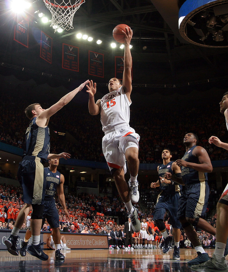 Virginia guard Malcolm Brogdon (15) shoots the ball surrounded by Georgia Tech  defenders during an NCAA basketball game Thursday Jan. 22, 2015, in Charlottesville, Va. (Photo/Andrew Shurtleff)