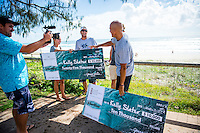 Tugun, Queensland Australia. (Friday March 21, 2014) –  Kelly Slater (USA) was presented with two checks this morning for Surfline's 2013 - 2014 Wave of the Winter and 2013 - 2014 US$10,000 Cliff Bar Overall Performance Award of the Winter. Sebastien Zietz (HAW) and Tommy Whitaker (AUS) surprised Kelly by jumping out from behind parked cars spraying him with soda water and presenting the US$25,000 Oakley Wave of the Winter check. Lachlan McKinnon (AUS) filmed the whole surpize. Photo: joliphotos.com