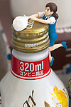 "A figure of ""Cup no Fuchiko"" climbs to the top of the bottle on August 19, 2014 in Tokyo, Japan. These mini figures are popular amongst young Japanese women who often use them when composing pictures of their lunch. The name Cup no Fuchiko translates to  or ""office lady, or OL, on the side of a cup"" and the figures are sold as drink ornaments. Made by  Kitan Club CO. LTD Cup no Fuchiko was created by the manga artist Katsuki Tanaka. There are currently 21 models of Cup no Fuchiko and Kitan Club has also made capsule toys from famous characters such as Street Fighter II, Moomin, Hello Kitty. (Photo by Rodrigo Reyes Marin/AFLO)"