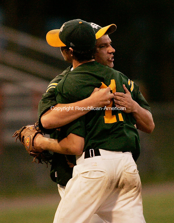 BRISTOL, CT - 07 June 2005 -060705BZ09- Holy Cross head coach Mike Phelan hugs pitcher #11, Tyler King after taking him out of the game against Sheehan <br /> in the class M semifinal at Muzzy Field Tuesday night.<br /> Jamison C. Bazinet Photo