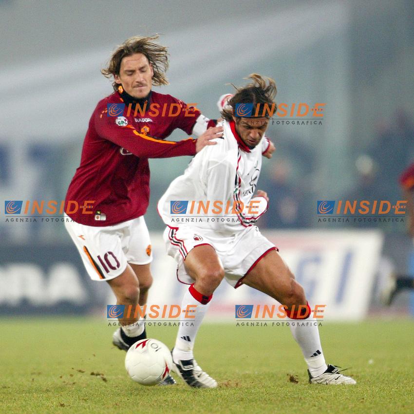Roma 6/1/2004 Roma - Milan 1-2<br /> Francesco Totti (Roma) and Paolo Maldini (Milan)<br /> Photo Andrea Staccioli / Insidefoto