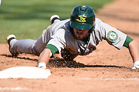 Beloit Snappers pinch runner Branden Cogswell (13) dives back to first during a game against the Clinton LumberKings on August 17, 2014 at Ashford University Field in Clinton, Iowa.  Clinton defeated Beloit 4-3.  (Mike Janes/Four Seam Images)