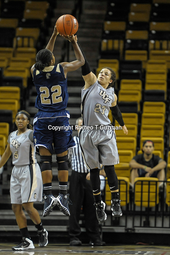 November 15, 2013 - Orlando, FL, U.S: FIU guard Jerica Colely (22) attempts a shot over UCF guard Briahanna Jackson (23) during second half women's NCAA basketball game action between the FIU Panthers and the UCF Knights. UCF defeated FIU 71-66 at CFE Arena in Orlando, Fl.