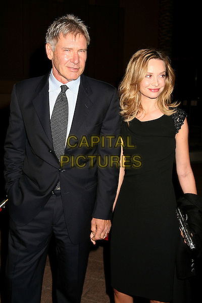 HARRISON FORD & CALISTA FLOCKHART.The Jules Verne Adventure Film Festival and Exposition Launch at The Shrine Auditorium, Los Angeles, California, USA, 06 October 2006..half length black dress couple holding hands.Ref: ADM/BP.www.capitalpictures.com.sales@capitalpictures.com.©Byron Purvis/AdMedia/Capital Pictures.