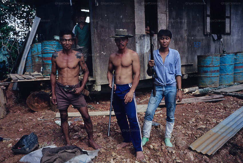 1989: Dayak hunters with cabin and shotguns. Limbang region, Sarawak, Borneo<br />