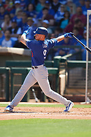 Gavin Lux (9) of the Los Angeles Dodgers follows through on a swing during a Cactus League Spring Training game against the Texas Rangers on March 8, 2020 at Surprise Stadium in Surprise, Arizona. Rangers defeated the Dodgers 9-8. (Tracy Proffitt/Four Seam Images)