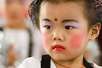 A beautiful young girl performs at an elementary school that is a mix of Chinese and Uyghur students in the remote Xinjiang Uyghur Autonomous Region of northwest China.