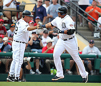 Detroit Tigers Miguel Cabrera #24 is congratulated by Gene Lamont after hitting a home run during a spring training game vs. the Boston Red Sox at Joker Marchant Stadium in Lakeland, Florida;  March 15, 2011.  Boston defeated Detroit 2-1.  Photo By Mike Janes/Four Seam Images