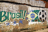 "Brazil. Brazilian flag , football and ""Brasil!"" painted on a wall."