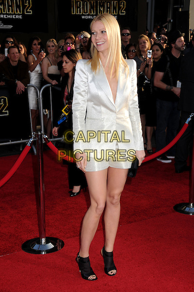 "GWYNETH PALTROW .""Iron Man 2"" World Premiere held at the El Capitan Theatre, Hollywood, California , USA, .26th April 2010..arrivals full length white silver shimmery shiny jacket suit shorts black ankle boots booties shooboots shoes open toe smiling blazer .CAP/ADM/BP.©Byron Purvis/AdMedia/Capital Pictures."
