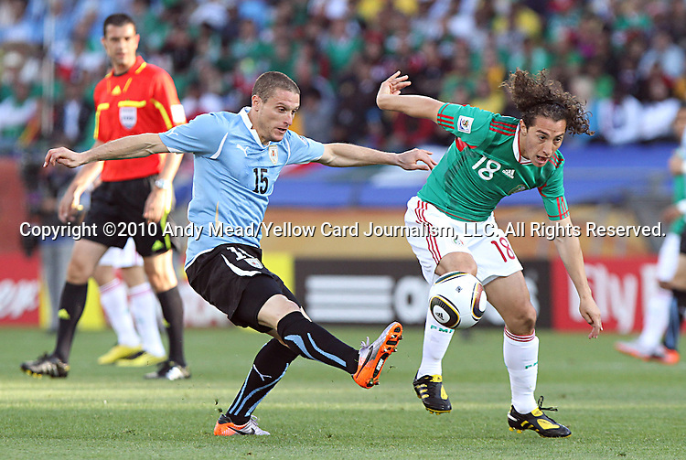 22 JUN 2010:  Diego Perez (URU)(15) steals the ball from Andres Guardado (MEX)(18).  The Mexico National Team went dow to the Uruguay National Team 0-1 in the first half at Royal Bafokeng Stadium in Rustenburg, South Africa in a 2010 FIFA World Cup Group A match.
