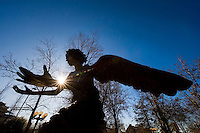 Angel sculpture at Chapel of Memories, backlit on winter morning (photo by Megan Bean / © Mississippi State University)