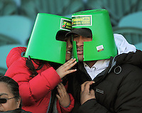 Injured Manawatu back Johnny Leota wears a bucket with his daughter Brooklyn. ITM Cup rugby - Manawatu Turbos v Wellington Lions at FMG Stadium, Palmerston North, New Zealand on Saturday, 4 September 2010. Photo: Dave Lintott/lintottphoto.co.nz