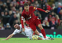 2nd January 2020; Anfield, Liverpool, Merseyside, England; English Premier League Football, Liverpool versus Sheffield United; Roberto Firmino of Liverpool evades a tackle from Enda Stevens of Sheffield United  - Strictly Editorial Use Only. No use with unauthorized audio, video, data, fixture lists, club/league logos or 'live' services. Online in-match use limited to 120 images, no video emulation. No use in betting, games or single club/league/player publications