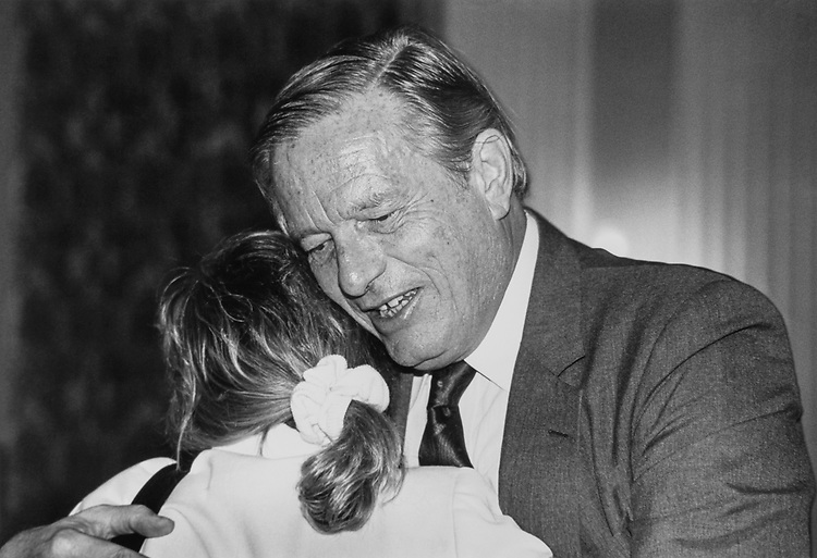 Rep. Susan Molinari, R-N.Y., gives Rep. Guy Vander Jagt, R-Mich., a big congratulatory hug after GOP leadership elections to pick chairman of NRCCE conference on Dec. 6, 1990. (Photo by Maureen Keating/CQ Roll Call)