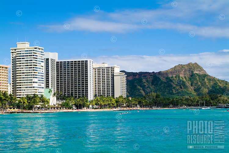 Sailing on the calm blue water off Waikiki Beach with Diamond Head in the background.