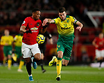 Anthony Martial of Manchester United tussles with Grant Hanley of Norwich City during the Premier League match at Old Trafford, Manchester. Picture date: 11th January 2020. Picture credit should read: James Wilson/Sportimage