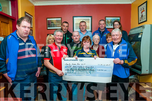 Cheque Presentation: Martin O'Flaherty of the Moyvane Motor Cycle Club presenting a cheque for €3590.00 to Michael Windle of the North Kerry Eagles, the proceeds of a poker run held in August at Enrights Bar, Moyvane on Saturday night last.